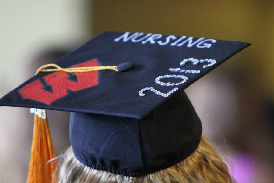 photo of a graduating nurse's mortarboard hat at graduation, decorated with