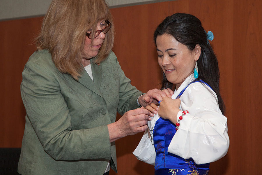 photo of a senior nursing student receiving a pin award