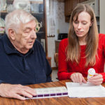 photo of Tonya Roberts working with an older adult in his home