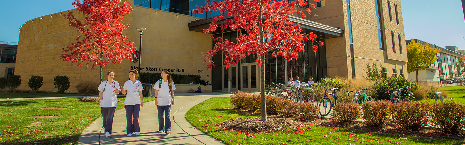 photo of nursing students walking in front of Cooper Hall